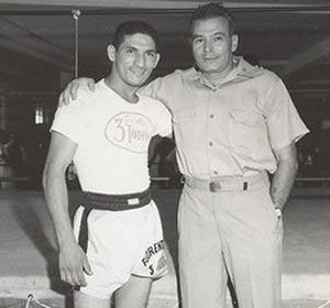 Florentino Fernández (izq.) junto al reconocido historiador del boxeo, Hank Kaplan.